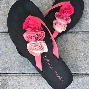 Marc Fisher flip flops with rose bud detail.
